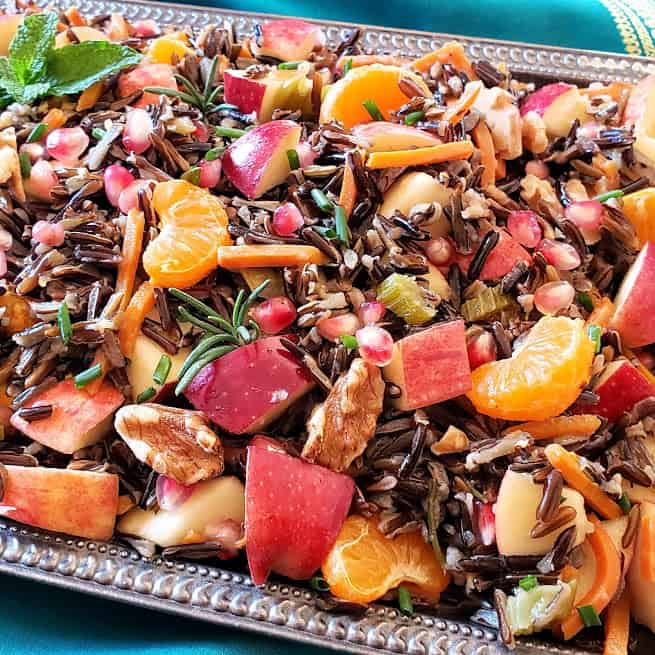 Wild Rice Pilaf stuffing along with apples, orages, walnuts and herbs served at holiday dinner.
