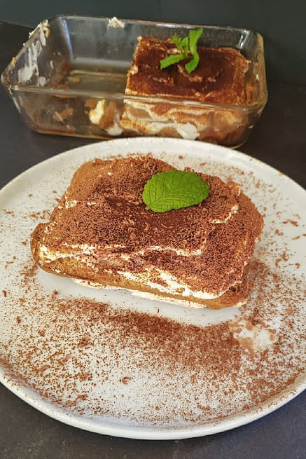 Showing 4 different layers of tiramisu made without eggs.