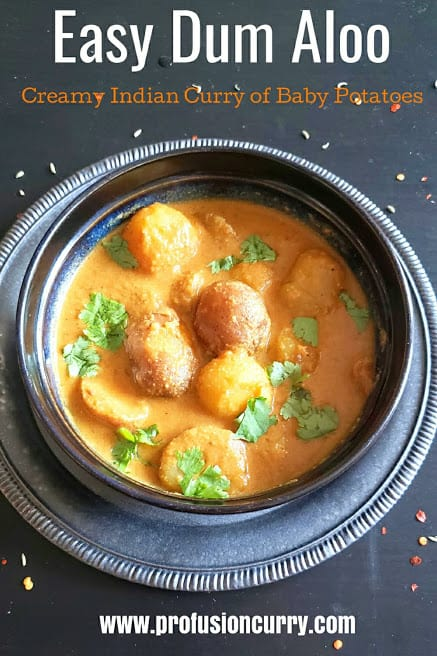 Pinterest image for Dum Aloo Curry which is Indian Creamy Curry made with baby potatoes.