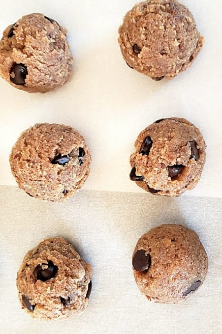 Almond flour chocolate chip dough scooped on parchement paper