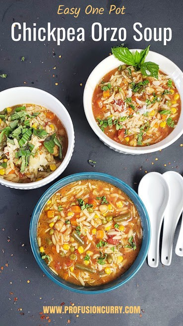 One pot Chickpea Orzo Vegetable soup served in bowls. This vegan recipe with pinterest image has text overlay.