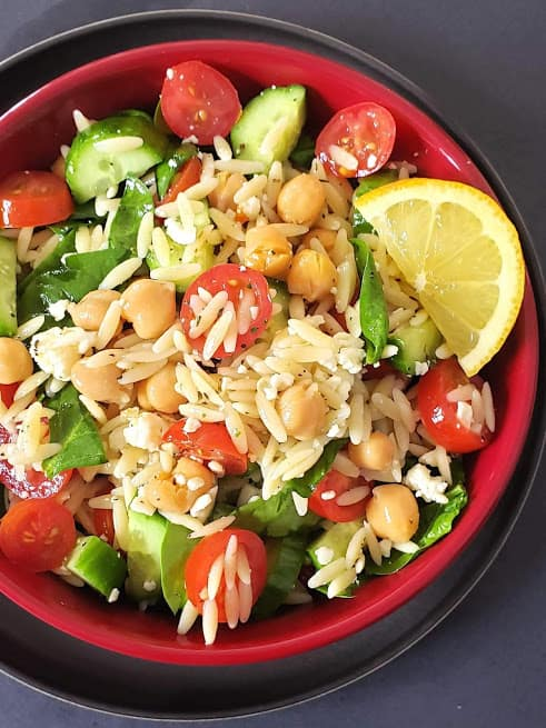 A close up showing all healthy and hearty ingredients used in this summer salad along with light homemade dressing.