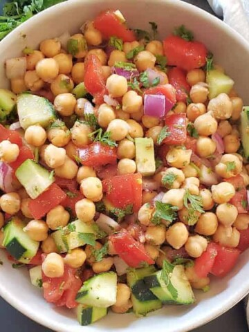 Healthy Chickpea Salad with veggies served with tangy lemon cumin dressing.