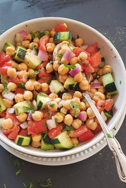 Crisp coolrful veggies mixed with cooked garbanzo beans to make easy salad.