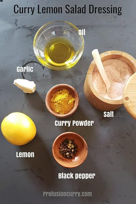 Ingredients used in making curry lemon salad dressing.