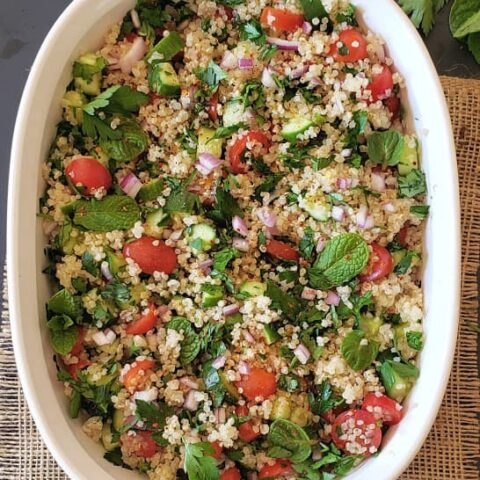 Healthy Quinoa Tabuli Salad served in a white serving bowl.