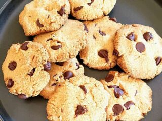 Almond Flour Chocolate CHip cookies served on a plate with sea salt flakes.