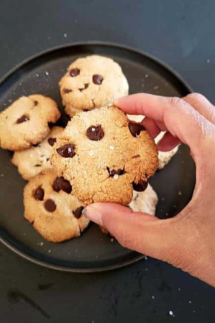 A hand picking up one of the cookies.