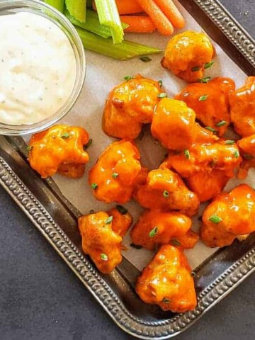 Spicy and non fried buffalo cauliflower wings served with creamy sauce. This vegetarian recipe is also gluten free and low in calorie made in air fryer.