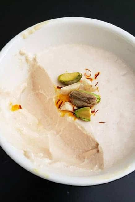 Thick and creamy sweet milk yogurt served in a white bowl.