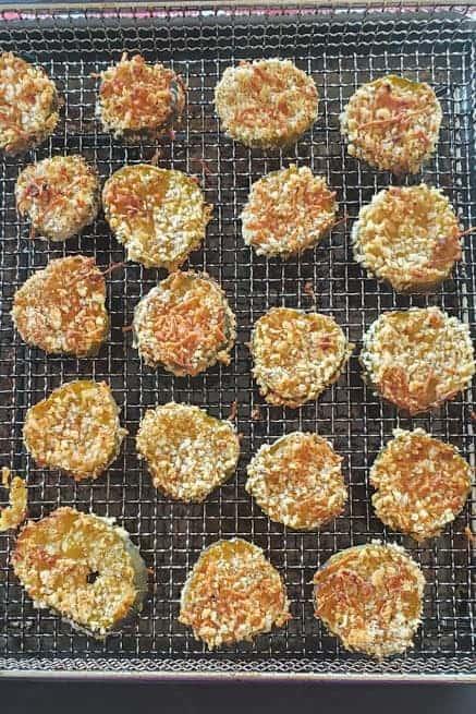 freshly made crispy crunchy fried pickles resting on the airfryer basket.