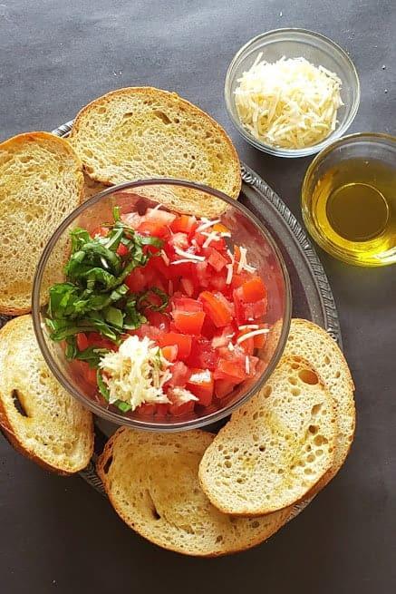 Prep wotk in making homemade Italian bruschetta.