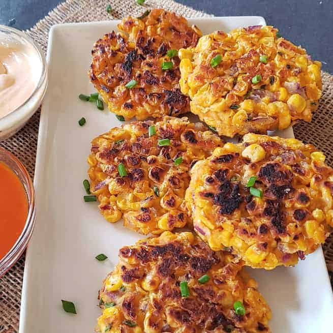 Vegan and gluten free corn fritters made in the air fryer and served with couple of dipping sauces.