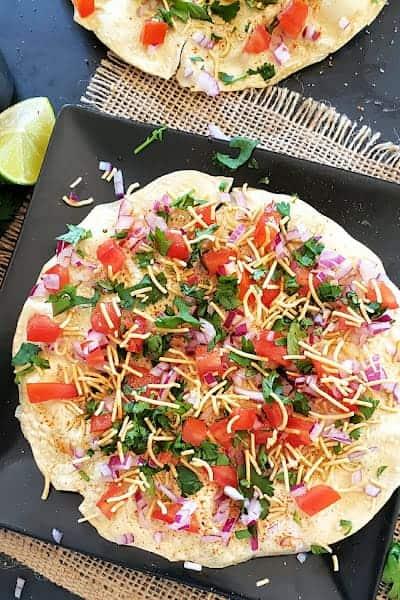 Colorfully layered masala papad.