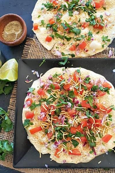 Vegan and gluten free masala papad served as an appetizer.