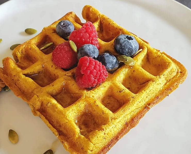 A close up of pumpkin waffle showing light and moist fluffy texture.